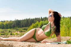 Summer beach stunning woman sunbathing in bikini Stock Photography