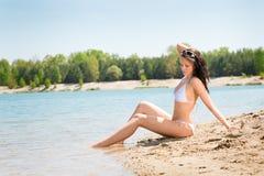 Summer beach stunning woman sunbathing in bikini Royalty Free Stock Image