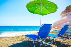 Summer beach with sun beds and umbrella. Stock Photography