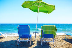 Summer beach with sun beds and umbrella. Royalty Free Stock Photos