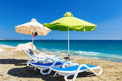 Summer beach with sun beds and umbrellas. Royalty Free Stock Photo