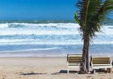 Summer beach sun chairs lounger near tropical sea Royalty Free Stock Image