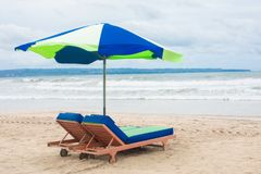 Summer beach sun chairs lounger sunbed near perfect tropical sea Stock Images