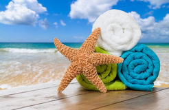 Summer Beach Towels. With starfish against ocean background