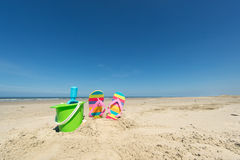 Summer beach. With toys and flip flops Royalty Free Stock Images
