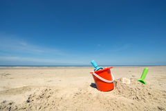 Summer beach. With toys and flip flops Royalty Free Stock Image
