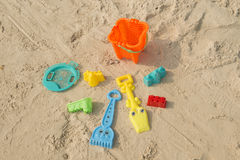 Summer beach toys in the sand Stock Photos