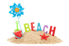 Summer beach. Beach with toys, starfish and sand isolated over white background Royalty Free Stock Photography