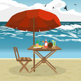 Summer on the beach: umbrella, sun, table, cocktail, coconut. Stock Image