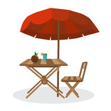 Summer on the beach: umbrella, sun, table, cocktail, coconut. Stock Images
