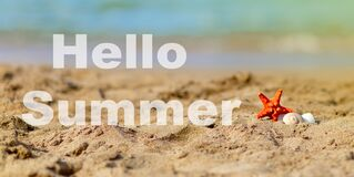 Summer beach vacation background with seashell  sand  sea  sunlight and lettering Hello Summer. Sea star shells on the sand beach