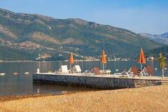 Summer beach vacation. Beautiful sunny Mediterranean landscape. Montenegro, Adriatic Sea, Bay of Kotor. Near Tivat city stock photography