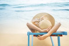 Summer beach vacation concept, Asia woman with hat relaxing and arm up on chair beach at Koh Mak, Trad, Thailand stock photos