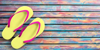 Summer beach vacation. Flip flops on colorful wooden background, top view, copy space. 3d illustration. Summer beach holidays. Flip flops on colorful wooden Stock Photo