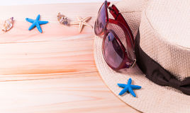 Summer beach vacation,straw hat,sunglasses ,Sea objects  on wood. En background with copy space Royalty Free Stock Photo