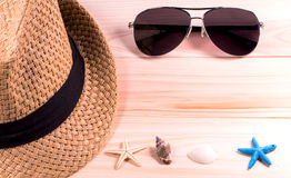Summer beach vacation,straw hat,sunglasses ,Sea objects  on wooden background Stock Photo