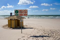 Summer beach in Ventspils. Beautiful summer day in city of Ventspils, Latvia. This is a main and clean beach in the city. Sand, clouds and waves in the Baltic stock images