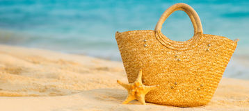 Free Summer Beach With Accessories. Blur Azure Sea On Background Royalty Free Stock Photos - 99074458