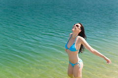 Summer beach woman in bikini swim water Stock Image