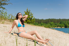 Summer beach woman in blue bikini Stock Photography