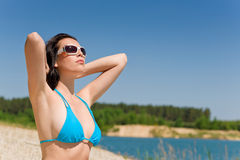 Summer beach woman in blue bikini bra Stock Photo