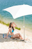 Summer beach woman blue bikini under parasol Royalty Free Stock Images