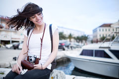 Summer beach woman fun holding vintage retro camera laughing and smiling happy during summer holiday vacation travel Royalty Free Stock Photo