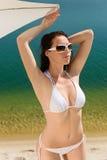 Summer beach woman posing in white bikini Royalty Free Stock Photography