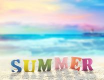 Word of color letters on summer beach and sea. Summer beach. Word summer of color letters on summer beach and sea as a background stock image