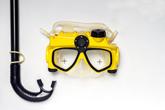 Summer on beach yellow and black diving mask camera on white ba Royalty Free Stock Photo