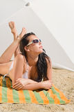 Summer beach young woman sunbathing in bikini Royalty Free Stock Image