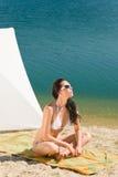 Summer beach young woman sunbathing in bikini Stock Photos