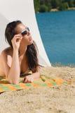 Summer beach young woman sunbathing in bikini Royalty Free Stock Photography