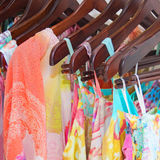 Summer beautiful clothes hanging in the store Royalty Free Stock Images