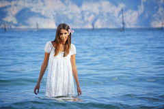 Summer beautiful female with flower in her hair Royalty Free Stock Photos