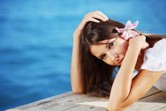 Summer beautiful female with flower in her hair Royalty Free Stock Image