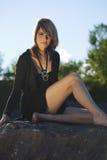Summer Beauty Sitting on Rock Outdoors Stock Photo