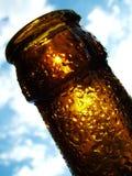Summer Beer. Macro of beer bottle neck backlit by the sun Stock Photo