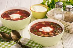 Summer beetroot soup with eggs, cucumbers and cream. Royalty Free Stock Photos