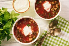Summer beetroot soup with eggs, cucumbers and cream. Royalty Free Stock Photo