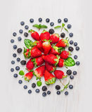 Summer berries:  blackberries, blueberries, strawberries , composing on white wooden background, top view Stock Images