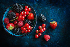 Summer berries in bowl Stock Photo
