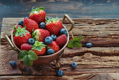 Summer berries in bowl. On wooden table, strawberry, raspberry and blueberry Stock Photography
