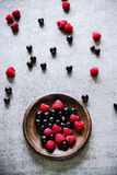 Summer berries in brown ceramic plate. Royalty Free Stock Photography