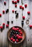 Summer berries in brown ceramic plate. Stock Photo
