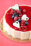 Summer Berries Cake. With white chocolate hearts, on a red background Stock Image