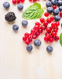 Summer berries close up, on white wooden background, corner frame Stock Photo