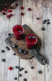 Summer berries and delicious detox smoothie on rustic. Wooden board royalty free stock photos