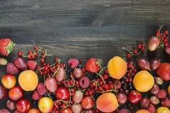 Summer berries and fruits on wood, backgrounds royalty free stock photography