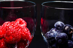 Summer berries. In glass bowls Stock Photography